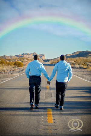 Gay couple walking under the rainbow